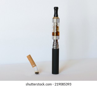 Electronic cigarette replacing tobacco cigarette concept