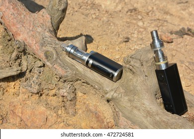 Electronic cigarette at the root of the tree