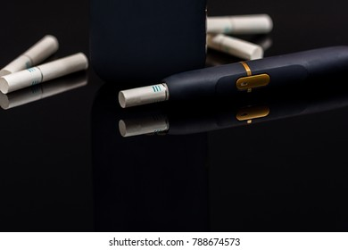 Electronic cigarette, tobacco heating system  on black background