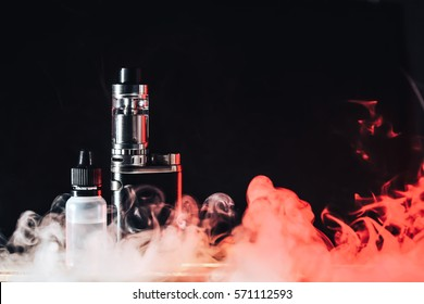 Electronic Cigarette, Vape with red smoke and liquid juice on a black and wooden background, evaporator, steam.