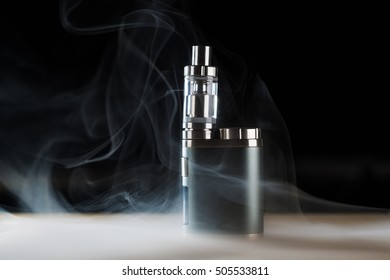 electronic cigarette, vape with a smoke on a black background