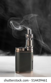 Electronic Cigarette, Vape with smoke on a black background, evaporator, steam