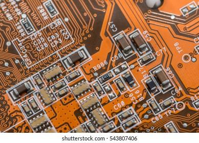 Electronic electronic circuit as background orange.