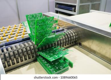 Electronic circuit board conveyors.