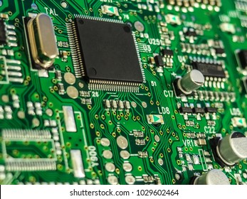 Electronic circuit board, PCB (Printed circuit board) with processor, microchips and glowing digital electronic signals.