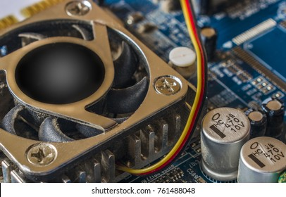 Electronic circuit board with processor and electrotechnical elements, close up.