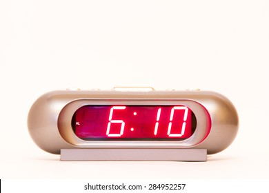 electronic clock alarm clock with red illumination and the time 6:10