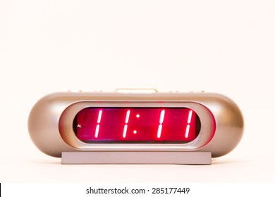 electronic clock alarm clock with red illumination and the time 11:11