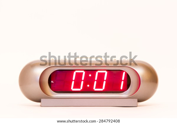 electronic clock alarm clock with red illumination and the time 0:01