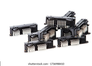 Electronic Components Concepts. Closeup of Rows of Long Angular PCB Connectors or Terminal Blocks Placed Randomly On White Background.Horizontal image
