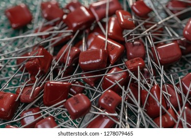 Electronic components, Lots of red film capacitors on PCB background