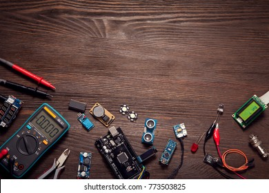 electronic components on a wooden background.