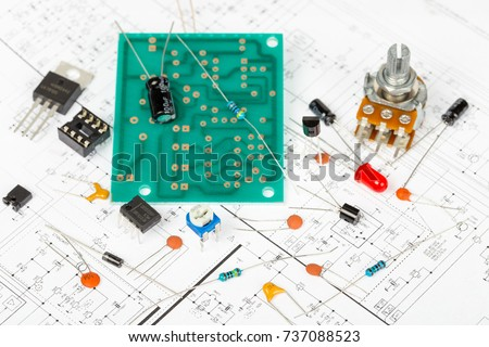 electronic components over electronic diagram printed stock photoelectronic components over electronic diagram, printed wiring, transistors, integrated circuits, capacitors,