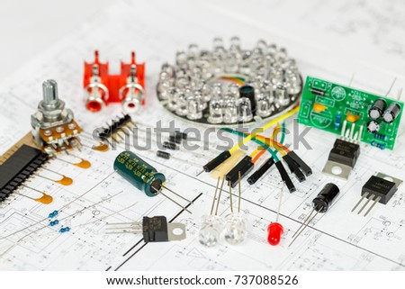 electronic components over electronic diagram printed stock photoelectronic components over electronic diagram, printed wiring, transistors, integrated circuits, capacitors, resistors, led, semiconductors, infrared leds