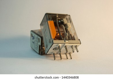 Electronic components: Pair of relays on light background