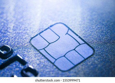 Electronic contactless credit card with selective focus microchip. Macro of a credit card.