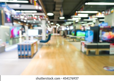 Electronic Department store with bokeh blurred background, Television Retail shop
