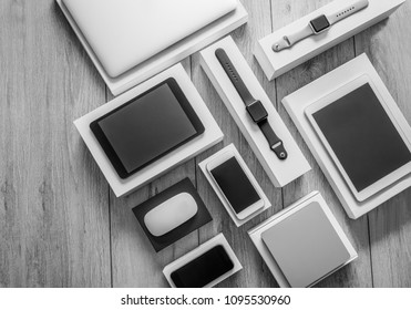 Electronic devices- computer, tablet, computer mouse, disc drive, smartphone and smart watch . Technology mock up. Black and white photo