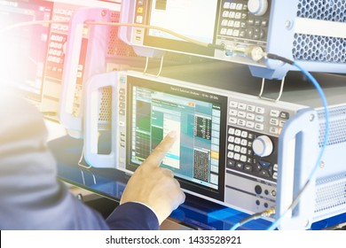 Electronic devices signal analizer and generator. Man operator hand