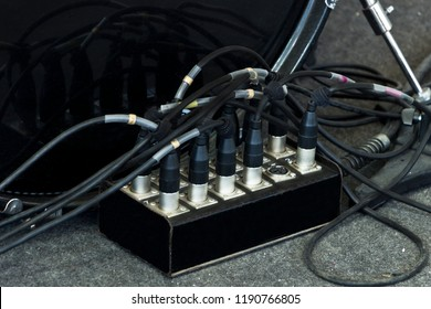 Electronic equipment - black microphones cables connected to the sound mixer