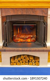 Electronic Fireplace With Ceramic Wood Logs in Home