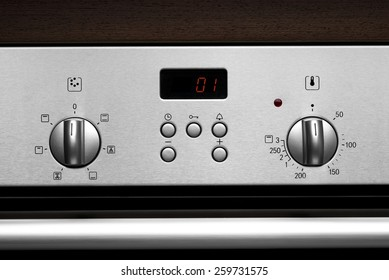 Electronic front panel of modern stainless steel kitchen oven
