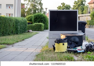 electronic garbage with a television, vacuum cleaner and other electrical appliances on the roadside