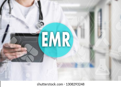 Electronic medical records. EMR on the touch screen with medicine icons on the background blur Doctor in hospital.Innovation treatment, service, data analysis health.