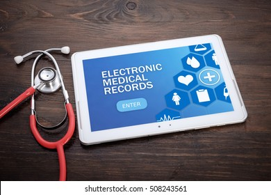 Electronic Medical Records on screen tablet pc, health concept. Information technology and mobile application in healthcare/medical.