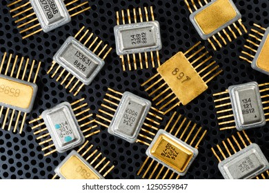 Electronic microcircuits and microchips close-up. Golden electronic components.