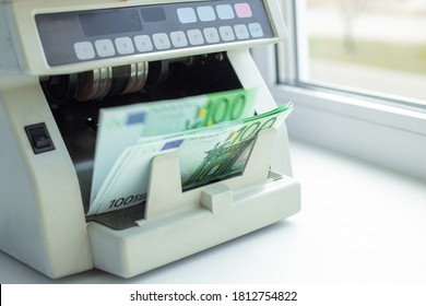 Electronic money counter machine is counting the euro banknotes. Automatic money counting in the machine - Image