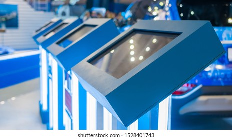 Electronic multimedia kiosks in row with touchscreen interactive displays at modern museum, trade show or exhibition. Education, design, entertainment, futuristic and technology concept
