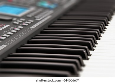 Electronic music instrument and art creation concept: 3D render of the macro view of black professional digital musical piano synthesizer with LCD display screen, buttons and other controls