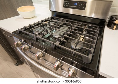 Electronic oven closeup in modern kitchen interior with stainless steel gas cook-top