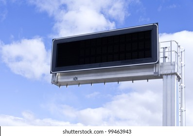 Electronic panel against a background of blue sky with clouds