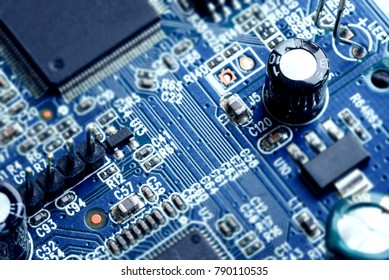 Electronic PCB printed circuit board in macro close-up with transistors circuitry and electric hardware elements including computer chip with copy space for computer industry designs and ideas