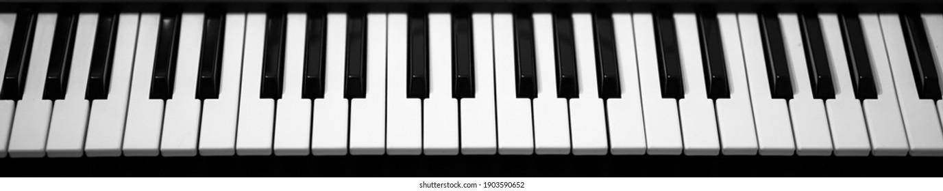 Electronic piano keyboard. Closeup of black and white piano keys