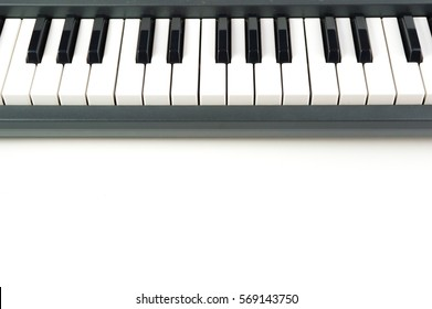 Electronic Piano Keyboard detail close up on white background with copy space