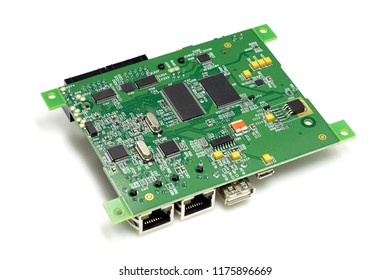 Electronic printed circuit board with chips and other components, green color, back side, angled view, isolated on white background