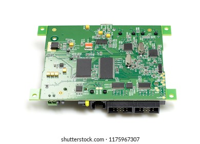 Electronic printed circuit board with chips and other components, green color, back side, isolated on white background