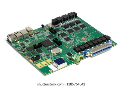 Electronic printed circuit board with chips and other components, green color, front side, angled view, isolated on white background
