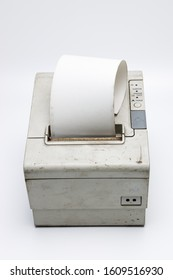 electronic recipe printer with paper roll, old and used printer on white isolated background with dirt and grunge, connected to a cash register
