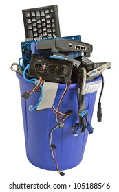 electronic scrap in trash can. keyboard, power supply, cables, logic board, hard drive - isolated on white background