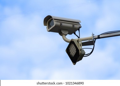 Electronic Security camera isolated over the sky
