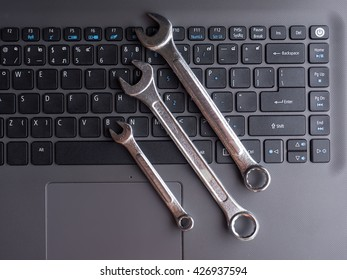 electronic technical support concep ,spanners on computer keyboard,  repair service , pc