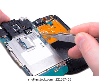 Electronic technician operates with mobile phone circuit board at electronic lab working place.Close-up with Shallow DOF. Isolated on white background.