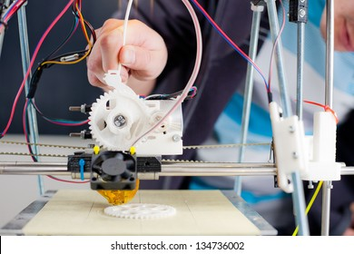Electronic three dimensional plastic printer during work in school laboratory, 3D printer, 3D printing