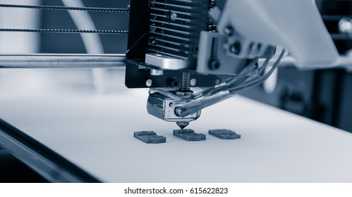 Electronic three dimensional plastic printer during work , 3D , printing.