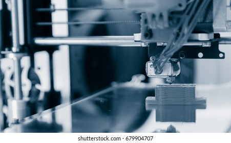 Electronic three dimensional plastic printer during work , 3D printer, 3D printing.3d printer mechanism working yelement design of the device during the processes