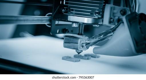 Electronic three dimensional plastic printer during work , 3D printer.